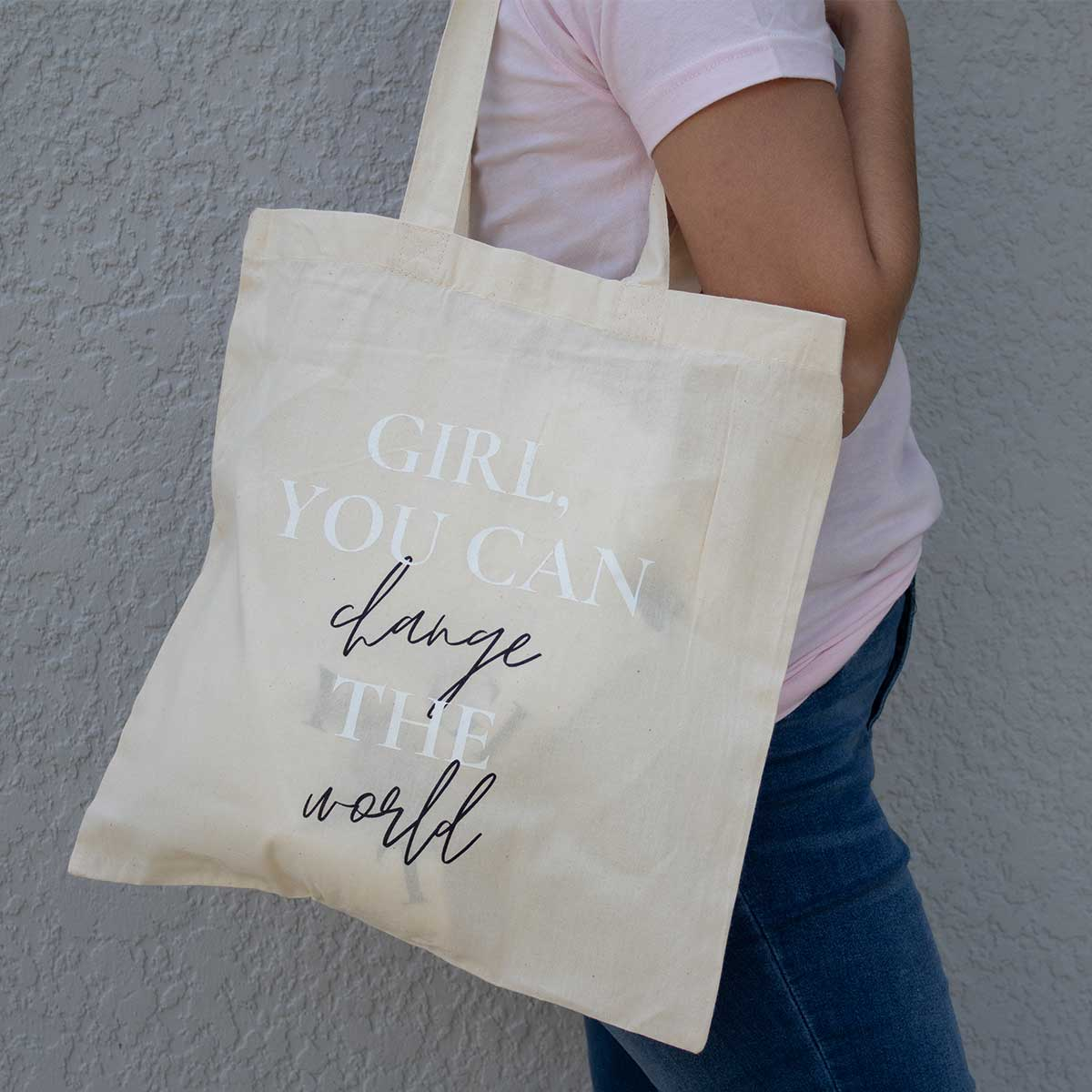 """Tote bag for sale that reads """"Girl... you can change the world"""""""